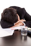 Business man sleeping over the desk Stock Photos