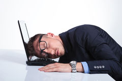 Business man sleeps on laptop Royalty Free Stock Photography