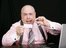 Business man with small paycheck Stock Image