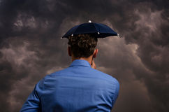 Business man with small umbrella Royalty Free Stock Photography
