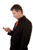 Business man with smart phone. Over white background Royalty Free Stock Photography