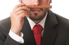 Business man smelling an original cuban cigar Stock Photo