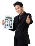 Business man  smile and Hold Calculator. Business man Made frightened and Hold Calculator isolated Royalty Free Stock Photos