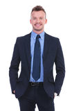 Business man smiles with hands in pockets Royalty Free Stock Photography