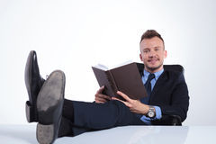 Free Business Man Smiles With Open Book Stock Photography - 40184332