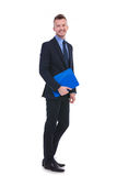 Business man smiles at you with his clipboard Stock Photo