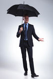 Business man smiles at you with umbrella Royalty Free Stock Photos