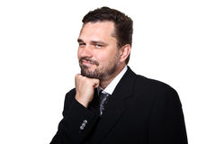 Business man smiling. Smiling business man making a grimace royalty free stock photo