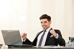 Business man smiling and celebrating a victory Royalty Free Stock Images