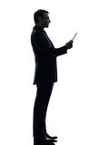 Business man smiling   digital tablet  silhouette Stock Photos