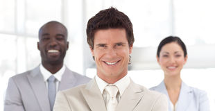 Business man smiling in front of Business team Royalty Free Stock Photography