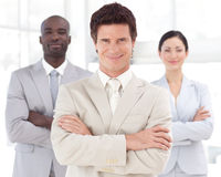 Business man smiling in front of Business team Stock Image