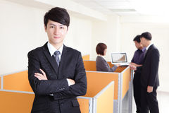 Business man smiling with a group Stock Photography