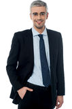 Business man smiling, hand in pocket. Businessman standing with hands in the pockets Stock Photography