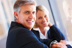 Business man smiling with his colleague Royalty Free Stock Photos