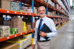 Business man is smiling during his work royalty free stock photo