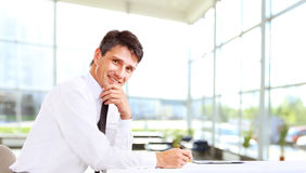 Business man smiling at the office Royalty Free Stock Image