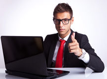 Business man smiling and pointing Stock Image