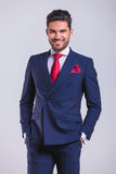 Business man smiling and posing with hands in pockets. Attractive business man smiling and posing with hands in pockets Stock Photos