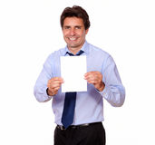 Business man smiling and showing you a card Royalty Free Stock Image
