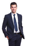 Business man smilling and holding his hand in the pocket Stock Photo