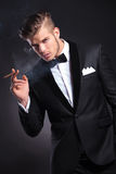 Business man smoking royalty free stock photo