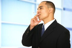 Business Man Smoking In Office Stock Photography