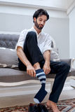 Business man socks. Professional man getting ready for work putting socks for work in morning at home Royalty Free Stock Photos