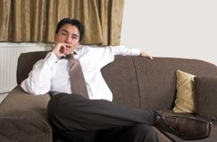 Business man on a sofa Royalty Free Stock Photos