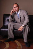 Business man on sofa. Royalty Free Stock Photography