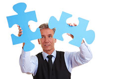 Business man solving oversized Royalty Free Stock Images