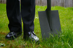 Business man with a spade Royalty Free Stock Photos