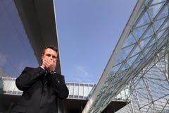 Business man, speak no evil, three monkeys concept. In urban scene stock photography
