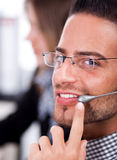 Business man speaking through head phone Stock Photography