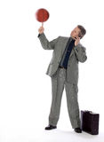Business Man and Spinning Basketball. A business man displays an ability to multitask with real talent stock images