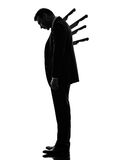 Business man Stabbed in the Back silhouette. One caucasian business man Stabbed in the Back in silhouette  on white background Stock Images