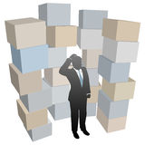 Business man in stacks of shipping boxes cartons Stock Photography