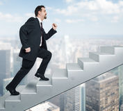 Business man and stairs. An image of a handsome business man moving upwards Stock Photography