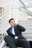 Business Man on Stairs with Phone Royalty Free Stock Photos