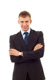 Business man stand with crossed hands. Young business man stand with crossed hands isolated Royalty Free Stock Photos