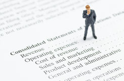 Business man stand on financial statement Stock Images