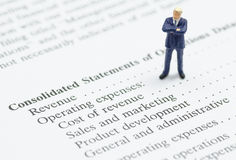 Business man stand on financial statement Stock Photos