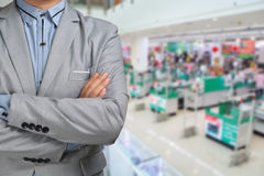 Business Man stand in Hypermarket or Supermarket store present r. Etail marketing Stock Image