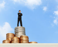 Business man stand on money Stock Image