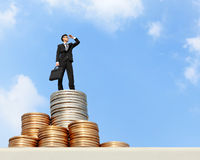 Business man stand on money Stock Photo