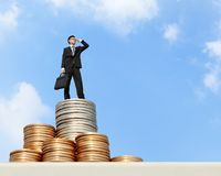 Business man stand on money Stock Images