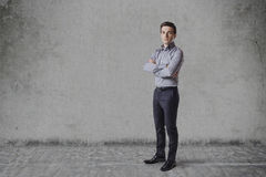 Business man  standing against vintage wall Stock Image