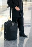Business man standing in the airport Royalty Free Stock Photography