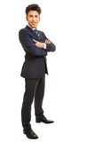 Business man standing with arms crossed Royalty Free Stock Photos