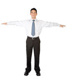 Business man standing with arms open Royalty Free Stock Photo